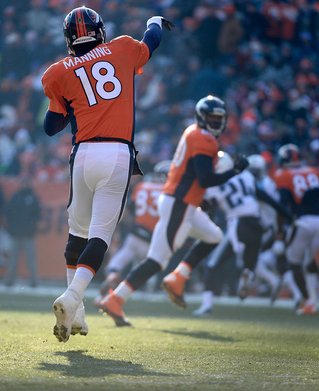 . DENVER, CO - DECEMBER 08: Denver Broncos quarterback Peyton Manning (18) makes a pass in the first quarter. The Denver Broncos take on the Tennessee Titans at Sports Authority Field at Mile High in Denver on December 8, 2013. (Photo by John Leyba/The Denver Post)