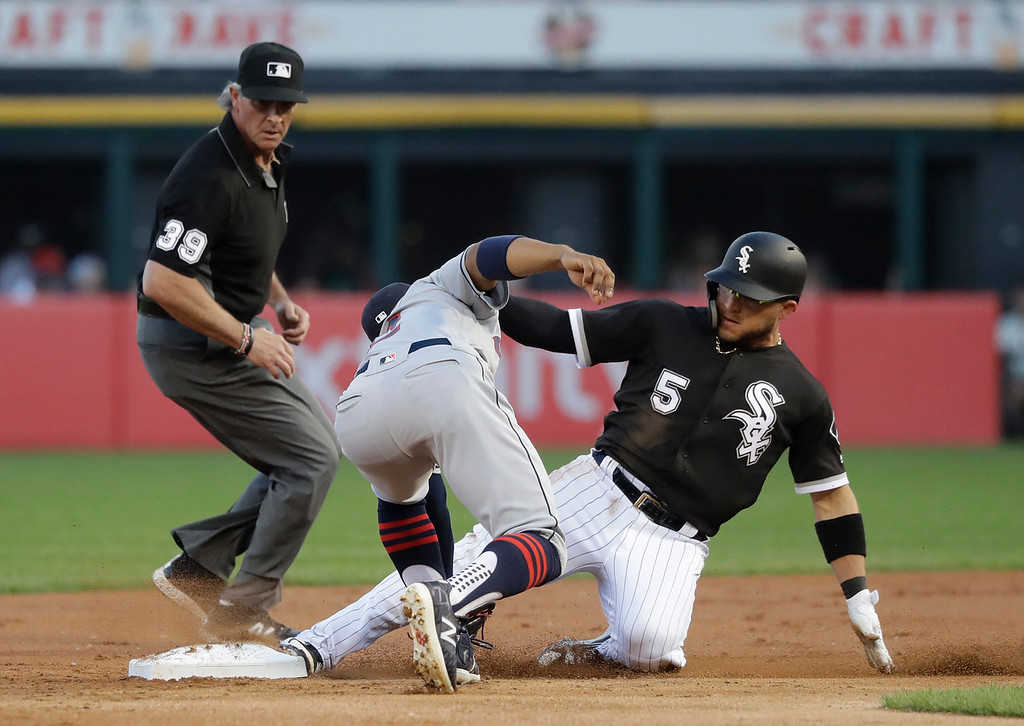 . Chicago White Sox\'s Yolmer Sanchez (5) steals second on a throw from Cleveland Indians catcher Roberto Perez to shortstop Francisco Lindor, as second base umpire Paul Nauert watches during the first inning of a baseball game Wednesday, June 13, 2018, in Chicago. The call was upheld after video review. (AP Photo/Charles Rex Arbogast)