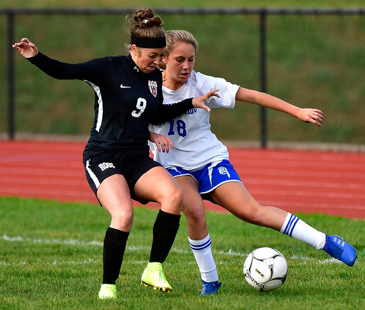 10/10/2019 Mike Orazzi | StaffrTerryville High School's Lena Stefano (9) and Nonnewaug's Samantha Conti (18) at THS on Thursday.