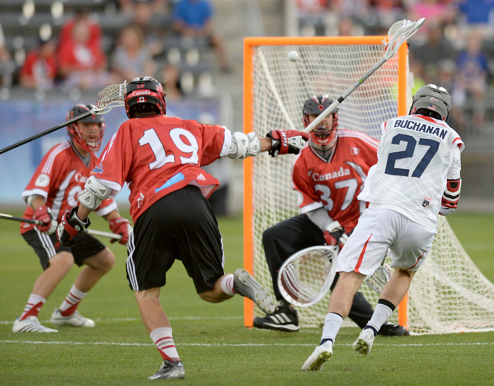 . United States midfielder Kevin Buchanan (27) fired a shot on net in the first quarter. The United States took on Canada in the opening game of the FIL World Lacrosse Championships Thursday night, July 10, 2014.   Photo by Karl Gehring/The Denver Post