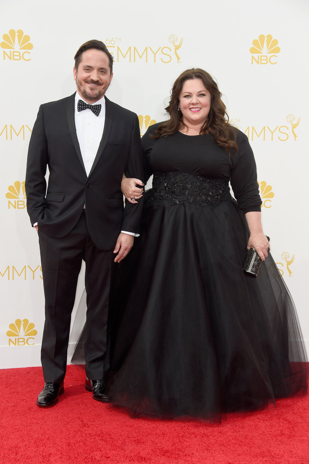 . Actors Ben Falcone (L) and Melissa McCarthy attend the 66th Annual Primetime Emmy Awards held at Nokia Theatre L.A. Live on August 25, 2014 in Los Angeles, California.  (Photo by Frazer Harrison/Getty Images)