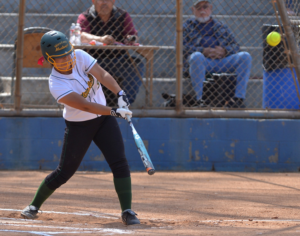 . 0517_SPT_TDB-L-MC-TORRANCE--- Torrance, CA--5/16/13--- Staff Photo: Robert Casillas  - Daily Breeze / LANG--- Mira Costa defeated Torrance High 7-1 in CIF DIV III softball playoff game at Wilson Park in Torrance. Brittany Werre strokes homer.