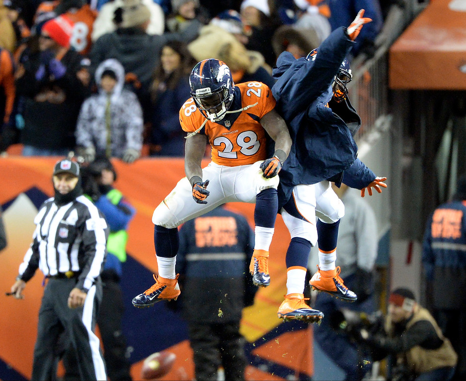 . Denver Broncos running back Montee Ball (28) celebrates a touchdown in the second half with C.J. Anderson.  The Denver Broncos vs. the Tennessee Titans at Sports Authority Field at Mile High in Denver on December 8, 2013. (Photo by Hyoung Chang/The Denver Post)