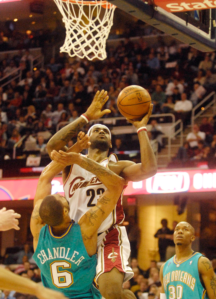 . Bridget Commisso/BCommisso@News-Herald.com  The Cavs Lebron James shoots a basket with secondsa left in the fourth quarter as the Hornets Tyson Chandler attempts to guard him.