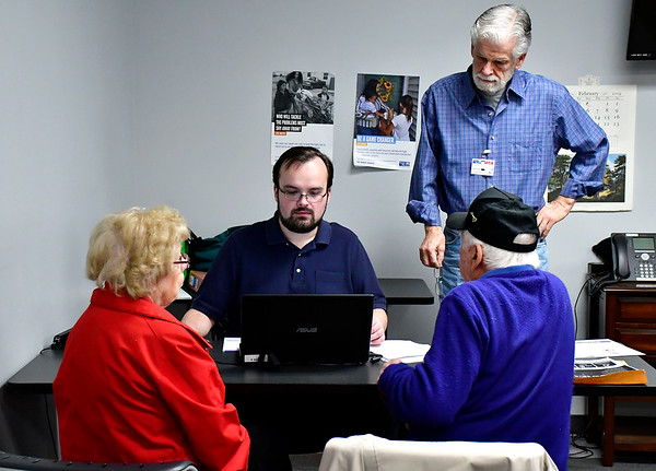 2/19/2019 Mike Orazzi | Staff Joe and Germaine Caminiti get help with their tax returns from Tomasz Kandybowicz of HRA and the United Way's David Radl during a program by the United Way of West Central Connecticut, in partnership with HRA of New Britain, for a free tax preparation site for individuals residing in Bristol, Burlington, Plainville, Plymouth and Terryville throughout the tax season in Bristol Tuesday.