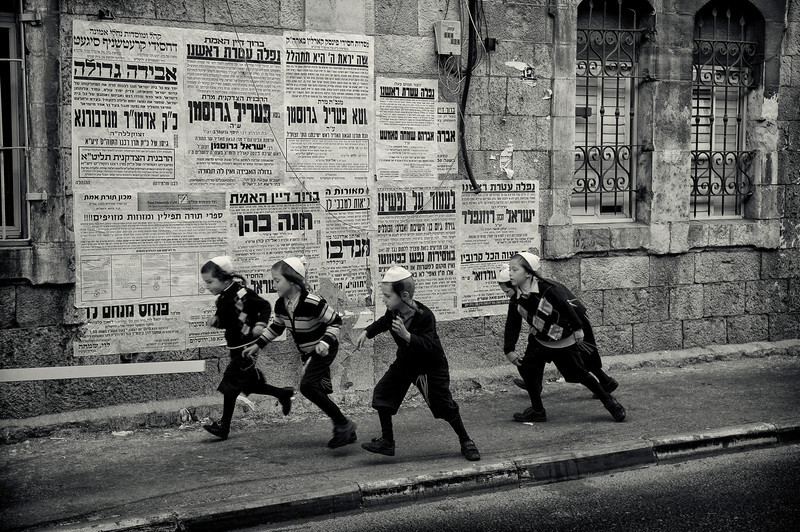 """Children running along the streets of Mea Shearim.  For more on Mea Shearim please visit the """"Meet the people"""" gallery.  Jerusalem, Israel, 2012."""