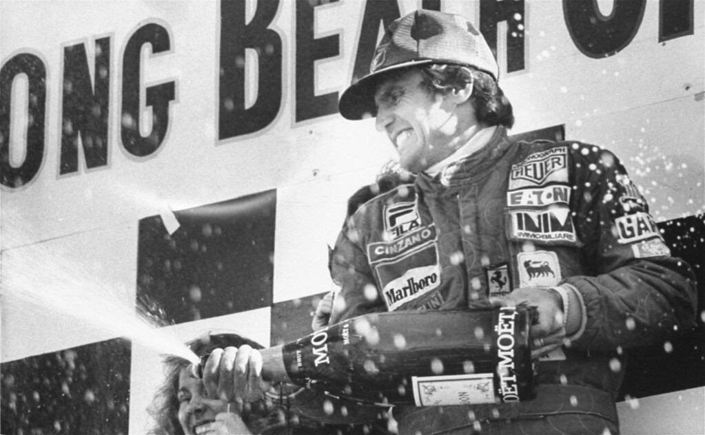 . Carlos Reutemann of Argentina gets some champagne in the face in Long Beach, Ca. April 2, 1978 after winning the Long Beach Grand Prix. Finishing second was Mario Andretti of the United States. (AP Photo/stf)