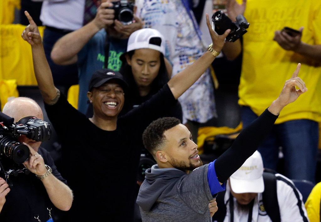 . Golden State Warriors\' Stephen Curry jokes with fans as he warms up before Game 1 of basketball\'s NBA Finals against the Cleveland Cavaliers Thursday, June 1, 2017, in Oakland, Calif. (AP Photo/Ben Margot)