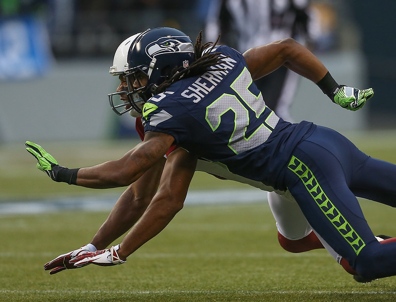 . Cornerback Richard Sherman #25 of the Seattle Seahawks defends on a pass intended for wide receiver Larry Fitzgerald #11 of the Arizona Cardinals at CenturyLink Field on December 9, 2012 in Seattle, Washington.  (Photo by Otto Greule Jr/Getty Images)