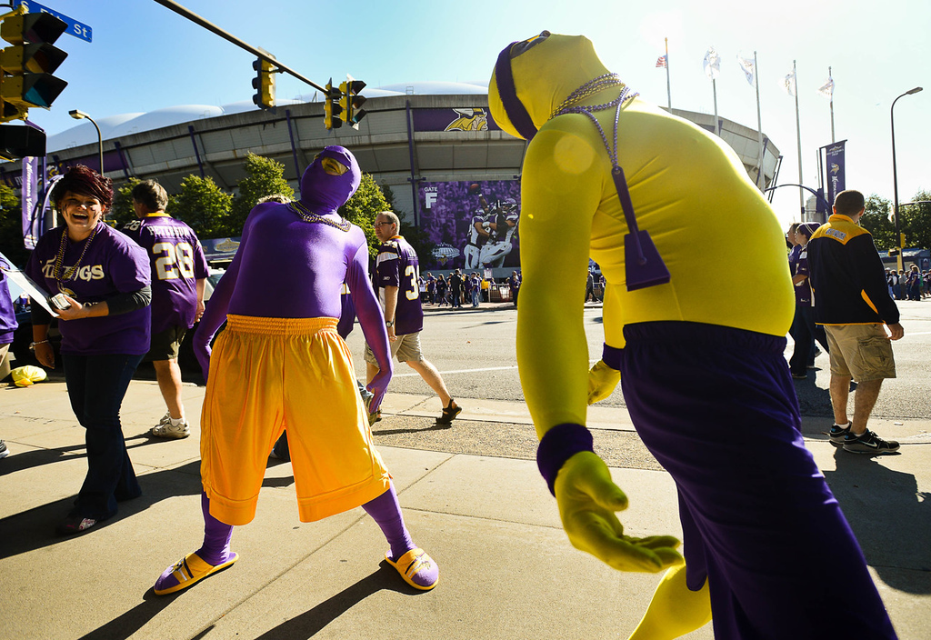 """. Mike Vondal, right, and Bob Kennedy of Dubuque, Iowa, do the \""""Bernie Move,\"""" inspired from the movie \""""Weekend at Bernie\'s,\"""" outside the Metrodome before the Vikings play the Browns.  (Pioneer Press: Ben Garvin)"""
