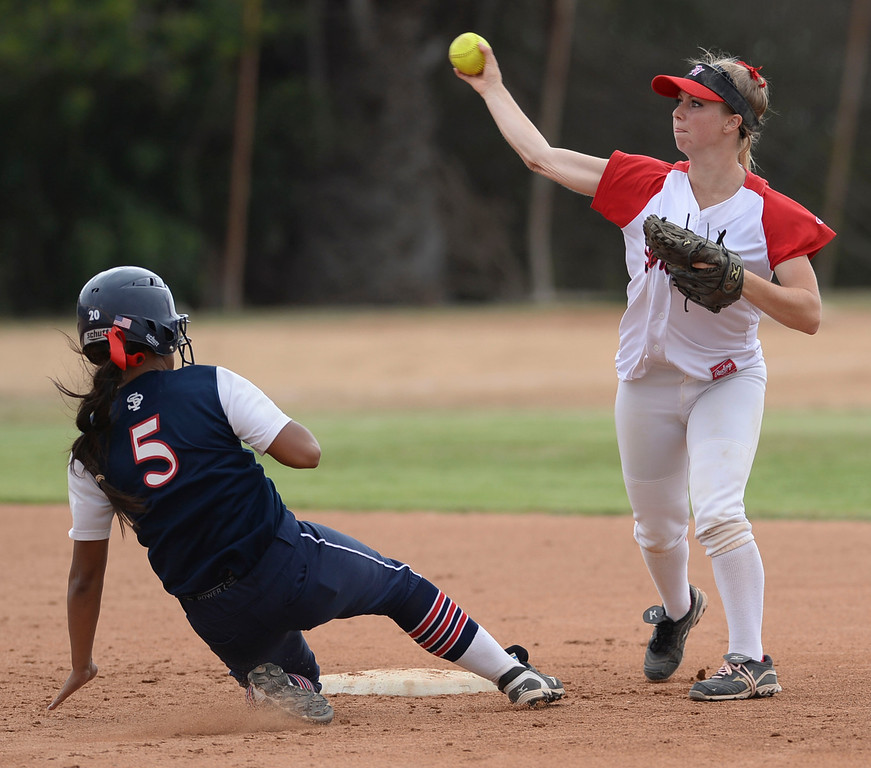. Palos Verdes\' Sami Silvestri (4) attempts a double play as St. Paul\'s Taylor Ancona (5) is out at second in a CIF-SS Division III semifinal softball game Tuesday, May 27, 2014, Palos Verdes Estates, CA.   Palos Verdes lost 10-0. Photo by Steve McCrank/Daily Breeze