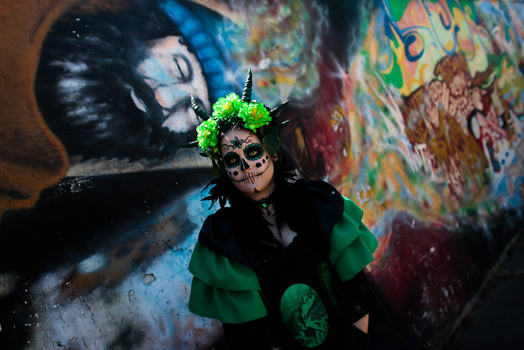 . A participant arrives at the Wave Gothic music  Festival in Leipzig, central Germany, Friday, June 6, 2014.  About 20,000 members of  the Gothic scene from all over the world are expected to attend  the 23rd edition of the Wave Gothic Festival that runs from June 6 to June 9, 2014 .  (AP Photo/Markus Schreiber)