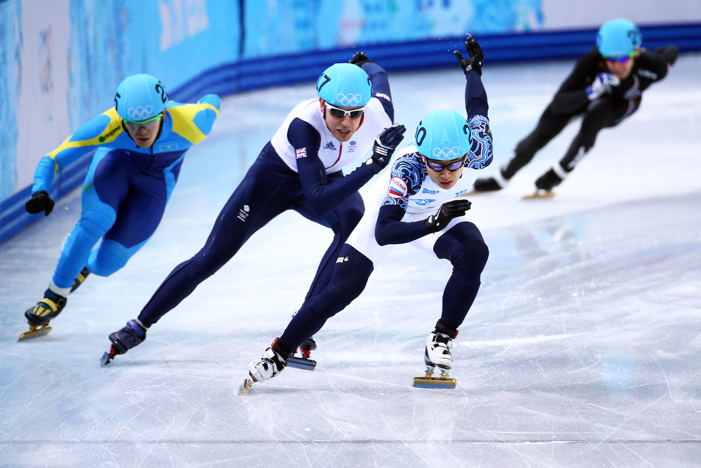 . Victor An of Russia leads to Jon Eley of Great Britain in the Short Track Men\'s 500m Heat at Iceberg Skating Palace on day 11 of the 2014 Sochi Winter Olympics on February 18, 2014 in Sochi, Russia.  (Photo by Streeter Lecka/Getty Images)