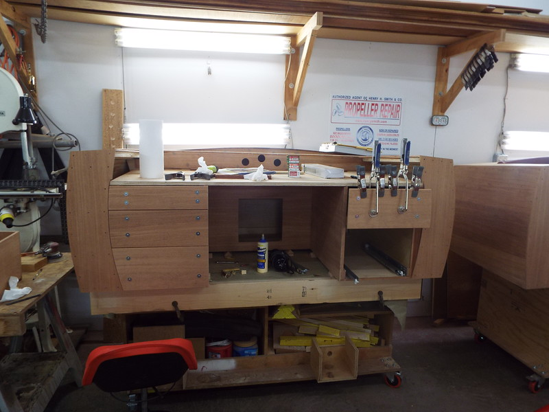 Drawer fronts being glued in place.