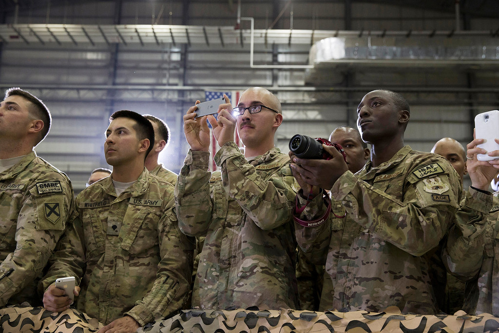 . U.S. Army soldiers look on as President Barack Obama speaks during a troop rally after arriving at Bagram Air Field for an unannounced visit, on Sunday, May 25, 2014, north of Kabul, Afghanistan. (AP Photo/ Evan Vucci)