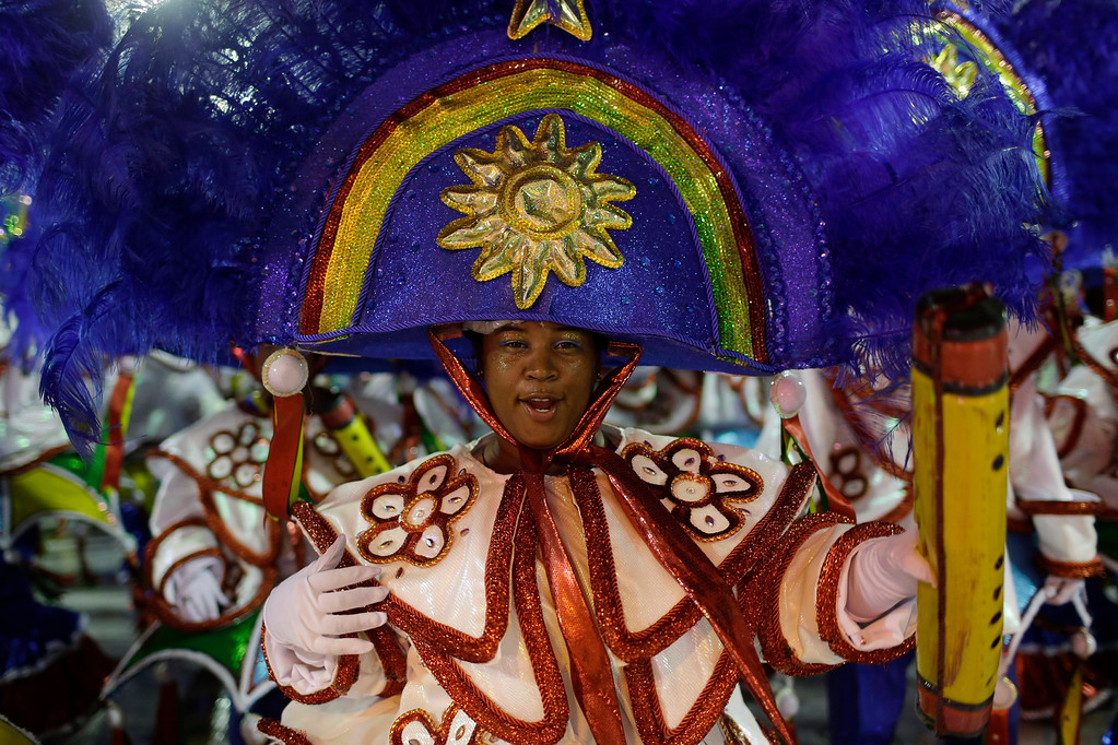 . A performer from the Paraiso do Tuiuti samba school parades during Carnival celebrations at the Sambadrome in Rio de Janeiro, Brazil, Sunday, Feb. 26, 2017. Competitors work for months to ready for Brazil\'s world famous Carnival parades of samba dancing, costumes and magnificent floats. (AP Photo/Leo Correa)