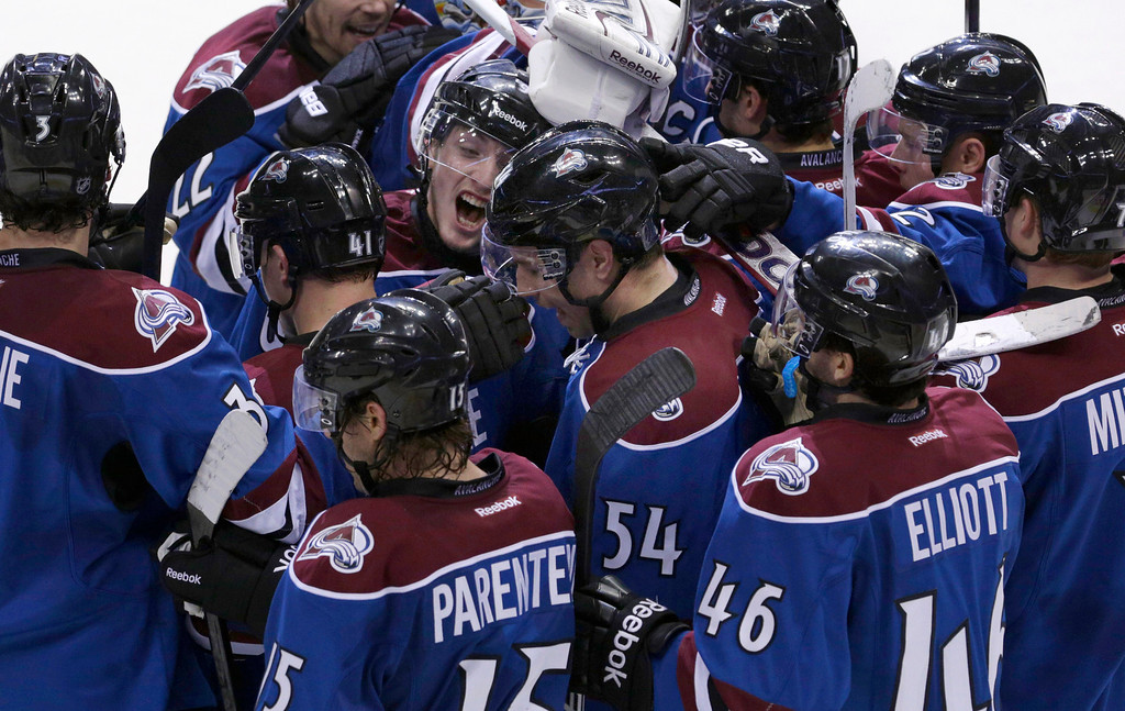 . Teammates congratulate Colorado Avalanche right wing David Jones (54) after he scored the game-winning goal in overtime against the St. Louis Blues in an NHL hockey game, Wednesday, Feb. 20, 2013, in Denver. Colorado won 1-0. (AP Photo/Joe Mahoney)