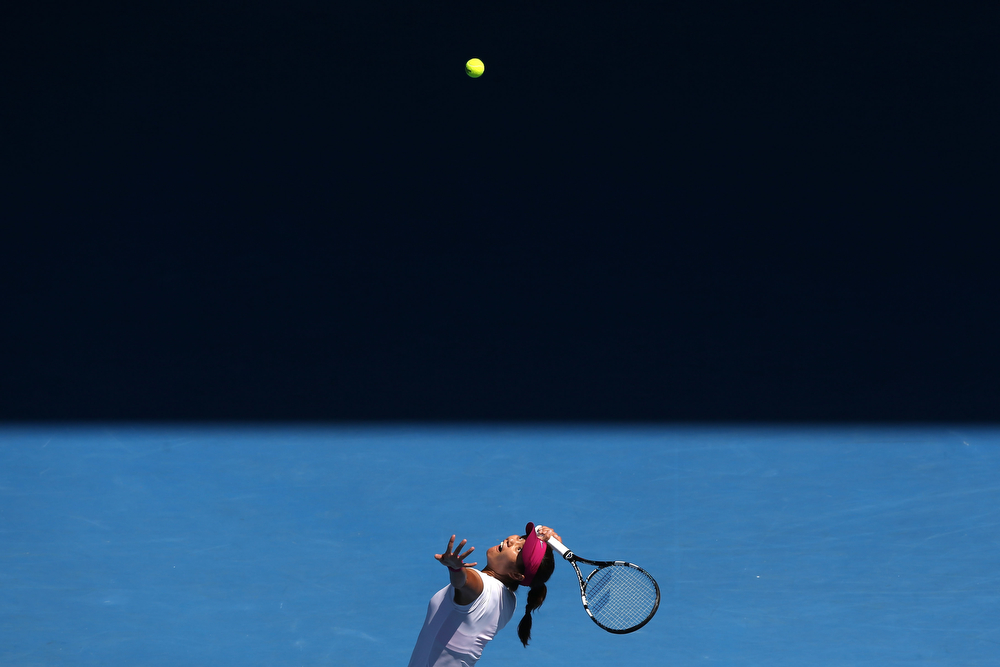 . Na Li of China serves in her semifinal match against Eugenie Bouchard of Canada during day 11 of the 2014 Australian Open at Melbourne Park on January 23, 2014 in Melbourne, Australia.  (Photo by Michael Dodge/Getty Images)