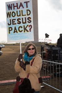"""""""What would Jesus pack?"""" asks a demonstrator at a gun-control rally in Washington D.C. 100 residents from Newtown, Connecticut and thousands of other gun-control activists gathered on Saturday, January 26, 2013 in Washington D.C. in a march down Constitution Ave. to a rally with speeches, musical performances and a poetry reading near the Washington Monument. (Photo by Jeff Malet)"""
