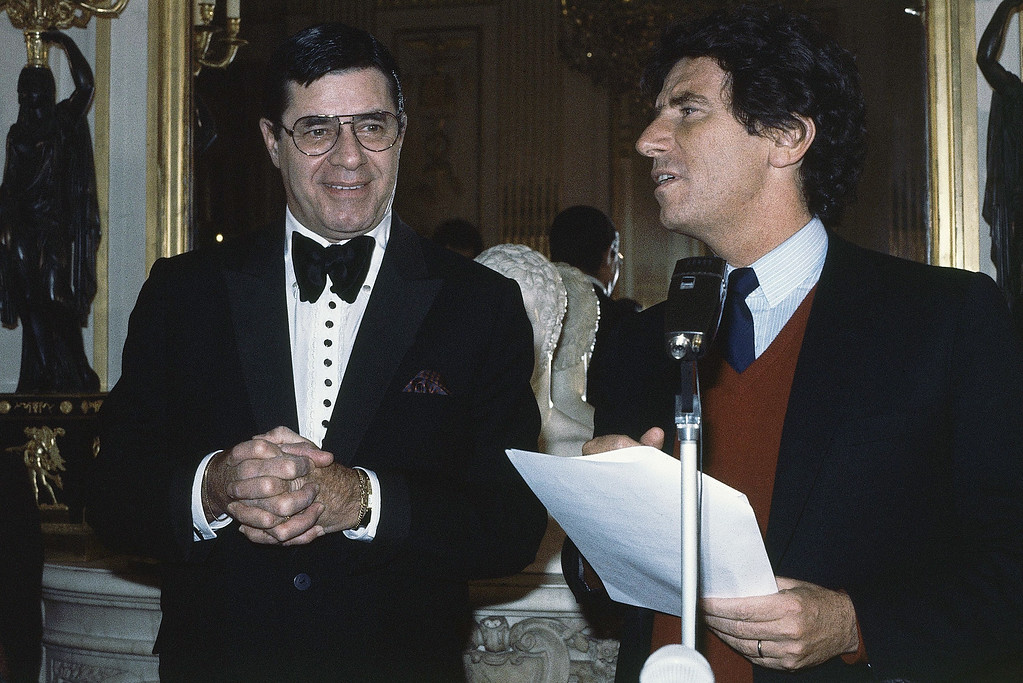 . Actor Jerry Lewis smiles while being awarded the French Medal of Honor by French Culture Minister Jack Lang during a ceremony held at his ministry, Jan. 13, 1984, Paris, France. (AP Photo/Lionel Cironneau)