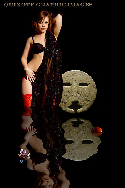 Jaimie and the god.  Jaimie Werner with a precolumbian stone mask from Mexico.   Composite image.