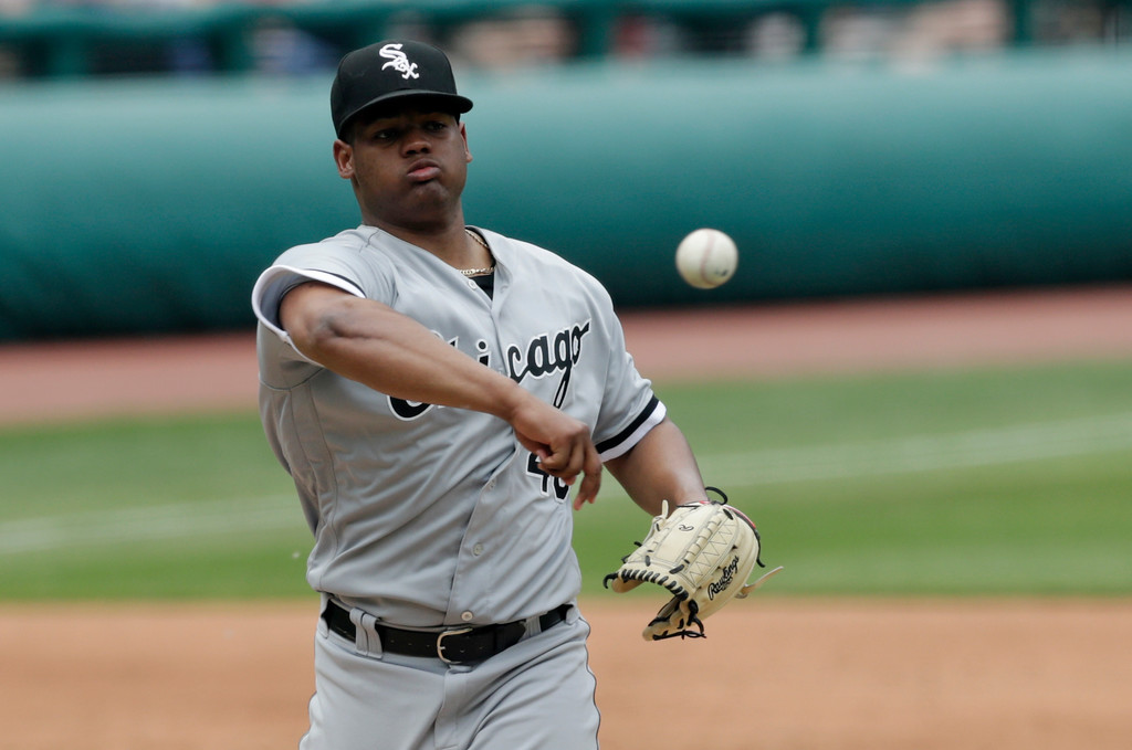 . Chicago White Sox starting pitcher Reynaldo Lopez throws to first base to get Cleveland Indians\' Michael Brantley in the third inning of a baseball game, Wednesday, May 30, 2018, in Cleveland. Brantley was able to get base to first base in time. (AP Photo/Tony Dejak)