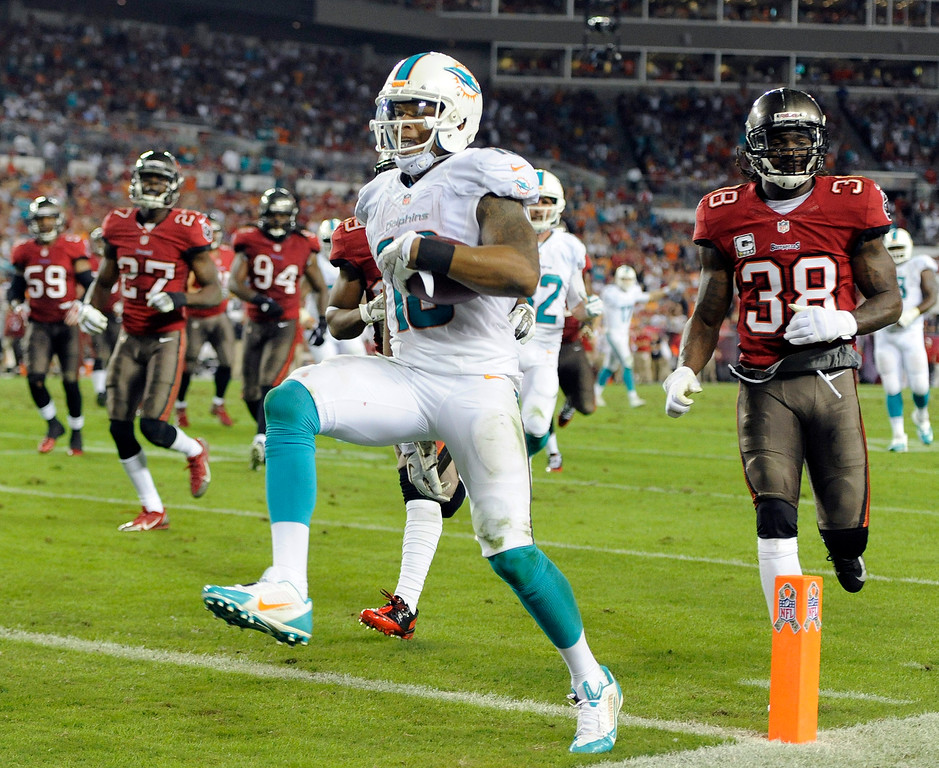 . Miami Dolphins wide receiver Rishard Matthews (18) scores past the Tampa Bay Buccaneers defense on a 19-yard touchdown reception during the third quarter of an NFL football game Monday, Nov. 11, 2013, in Tampa, Fla. (AP Photo/Brian Blanco)