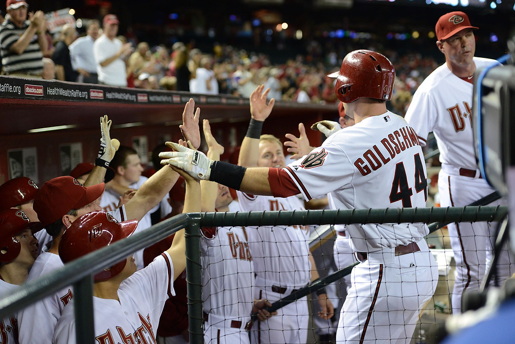 . PHOENIX, AZ - APRIL 25:  Paul Goldschmidt #44 of the Arizona Diamondbacks celebrates with his teammates after hitting a two run home run in the fourth inning against the Colorado Rockies at Chase Field on April 25, 2013 in Phoenix, Arizona.  (Photo by Norm Hall/Getty Images)