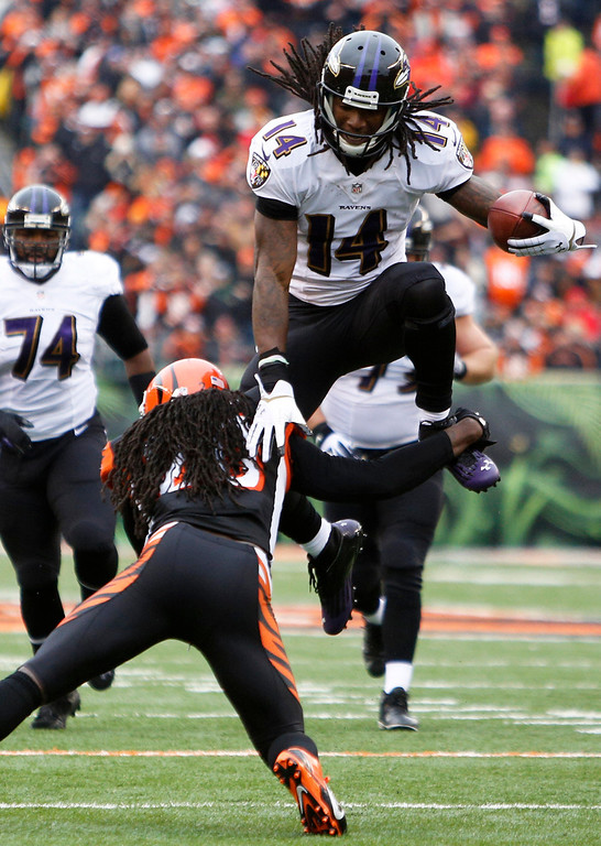 . Baltimore Ravens wide receiver Marlon Brown (14) is tackled by Cincinnati Bengals free safety Reggie Nelson in the second half of an NFL football game on Sunday, Dec. 29, 2013, in Cincinnati. (AP Photo/David Kohl)