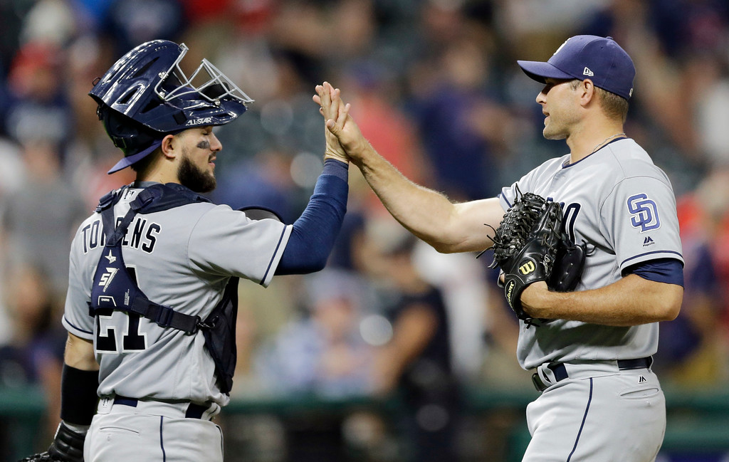 . San Diego Padres\' Luis Torrens, left, and relief pitcher Craig Stammen celebrate after the Padres defeated the Cleveland Indians 6-2 in a baseball game, Wednesday, July 5, 2017, in Cleveland. (AP Photo/Tony Dejak)
