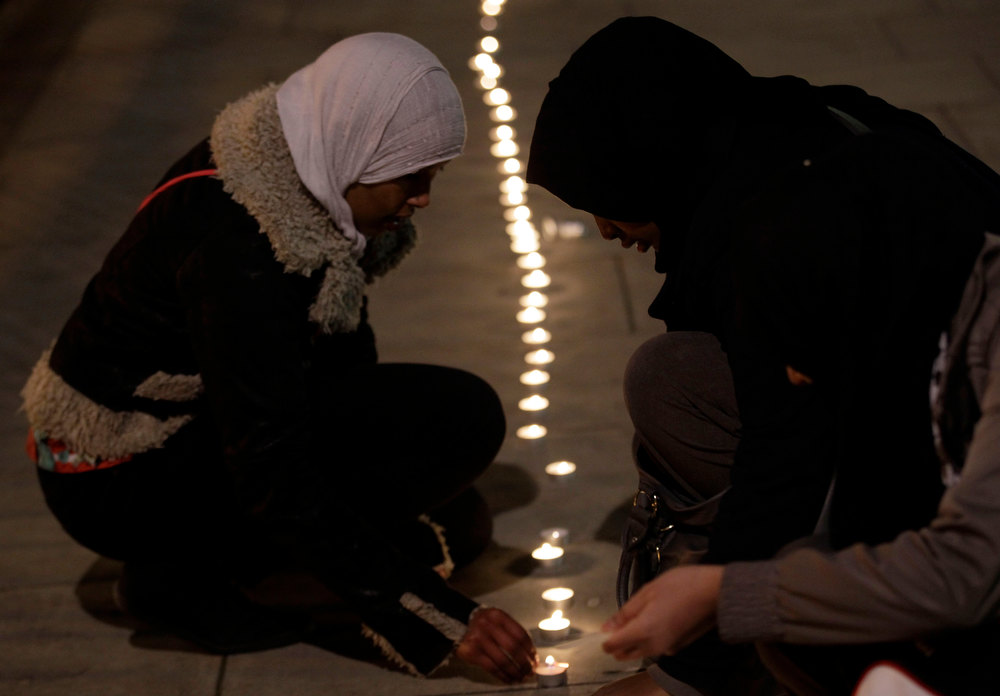 . Campaigners light a symbolic line of candles as they gather outside the U.S. Embassy in London to mark the 11th anniversary of the opening of Guantanamo Bay U.S. prison in eastern Cuba, Friday, Jan. 11, 2013. (AP Photo/Sang Tan)