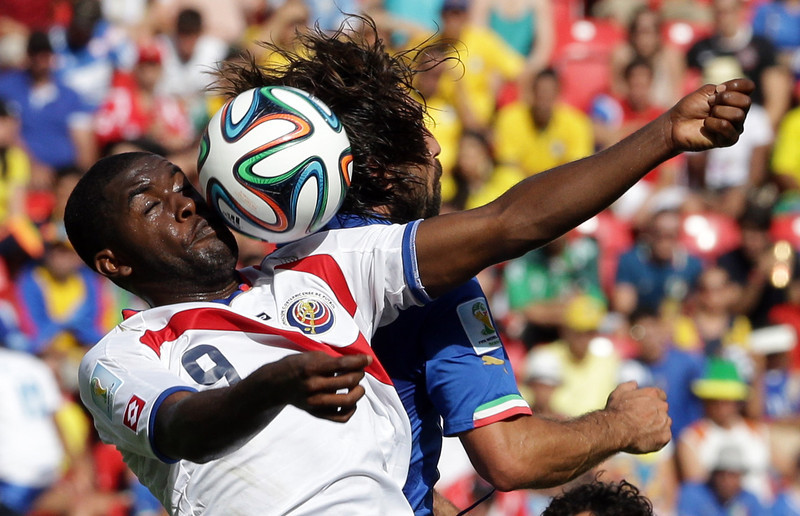 . Costa Rica\'s Joel Campbell, left, and Italy\'s Andrea Pirlo battle for the ball during the group D World Cup soccer match between Italy and Costa Rica at the Arena Pernambuco in Recife, Brazil, Friday, June 20, 2014. (AP Photo/Antonio Calanni)