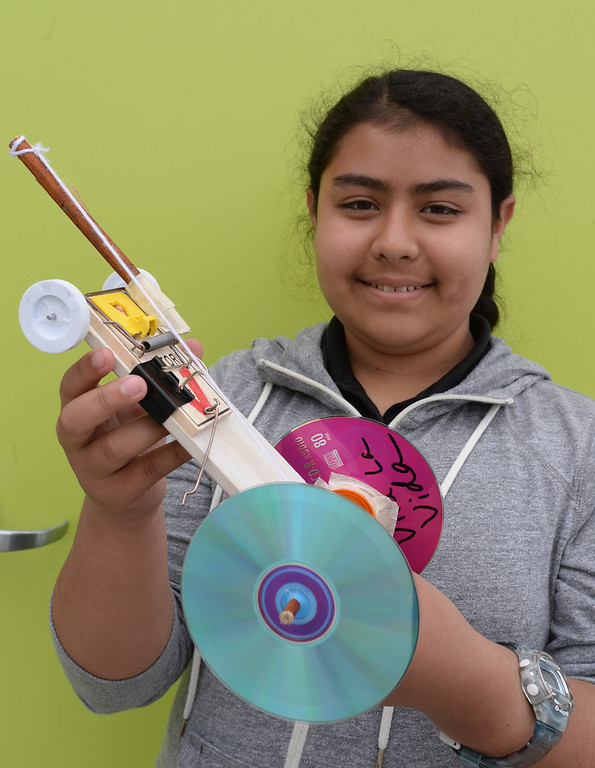 . New Environmental Charter Middle School in Gardena is located on the property of a former church. It serves about 360 students. Cecilia Carrera with her mousetrap-powered car. Photos by Brad Graverson 5-22-13