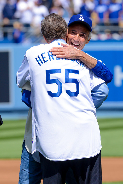. Sandy Kofax and Orel Hershiser hug after Kofax threw out the first pitch  at opening day at Dodger Stadium Monday.  Photo by David Crane/Los Angeles Daily News.