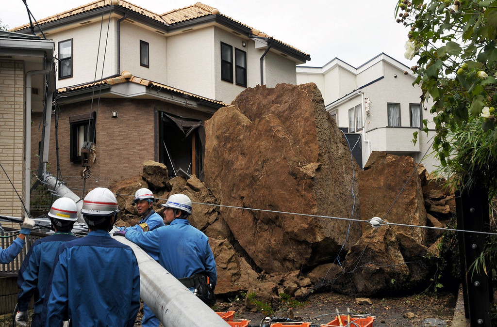 . A house and an electric pole smashed by large rocks from a collapsed slope caused by heavy rain in Kamakura, suburban Tokyo on October 16, 2013.  AFP PHOTO / JIJI PRESS /AFP/Getty Images