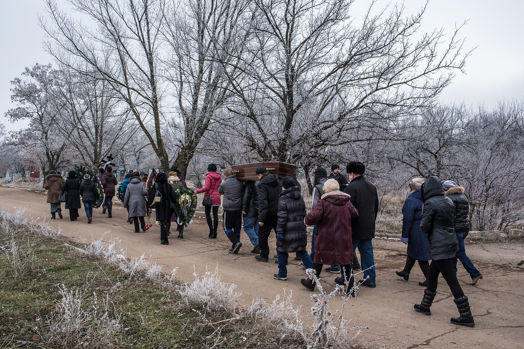 . ARTEMIVSK, UKRAINE - FEBRUARY 15: Family and friends carry the casket of Igor Molodetskykh, 7, who was killed two days prior when a shell hit his school on February 15, 2015 in Artemivsk, Ukraine. A ceasefire scheduled to go into effect at midnight was reportedly observed along most of the front, save for near the embattled town of Debaltseve. (Photo by Brendan Hoffman/Getty Images)