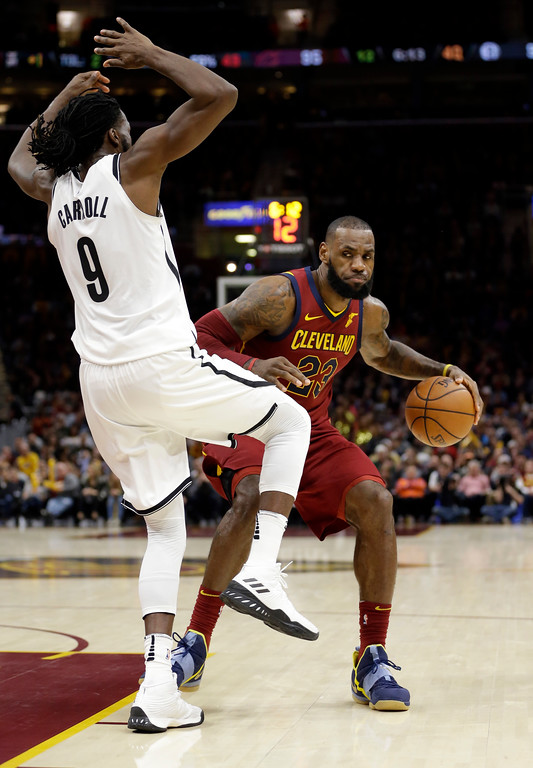 . Cleveland Cavaliers\' LeBron James (23) drives against Brooklyn Nets\' DeMarre Carroll (9) during the second half of an NBA basketball game, Wednesday, Nov. 22, 2017, in Cleveland. The Cavaliers won 119-109. (AP Photo/Tony Dejak)