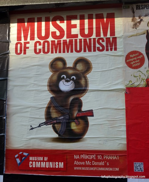 Poster for the museum of communism in Prague, Czech Republic in February 2014. A bear with a kalashnikov