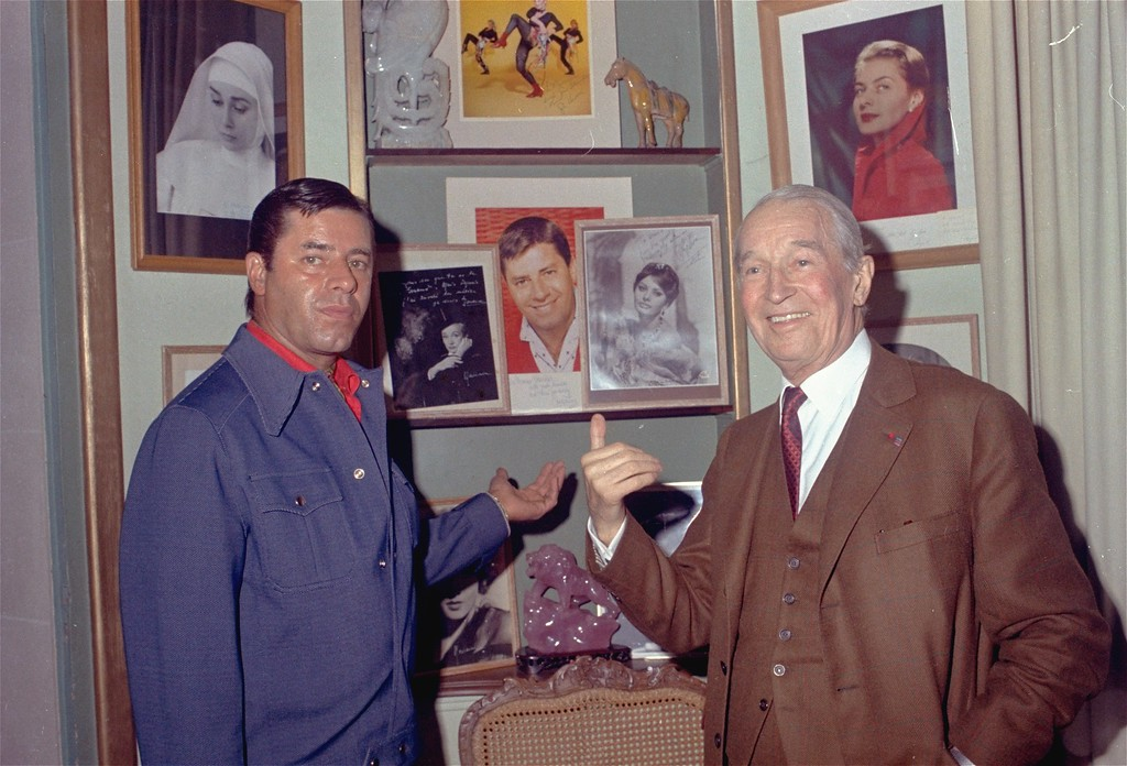 . Maurice Chevalier, (retired actor) shown with American comedian Jerry Lewis who visited him on his 83rd birthday at his home in suburban Marnes-La-Coquette, outside of Paris, September 12, 1971. (AP Photo/Michel Lipchitz)