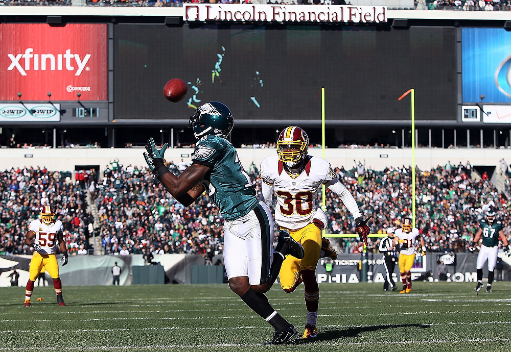 . Jeremy Maclin #18 of the Philadelphia Eagles catches a touchdown in the first quarter as DJ Johnson #30 of the Washington Redskins defends at Lincoln Financial Field on December 23, 2012 in Philadelphia, Pennsylvania.  (Photo by Alex Trautwig/Getty Images)