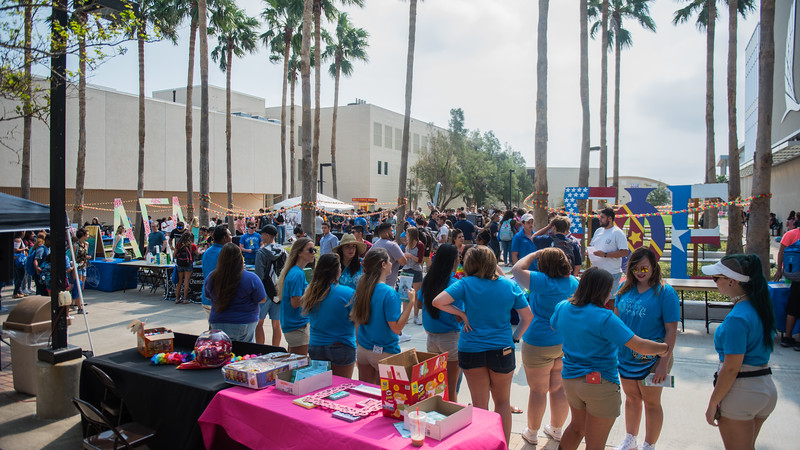 Organizations gather together as they greet students at the Aloha Org Fair.