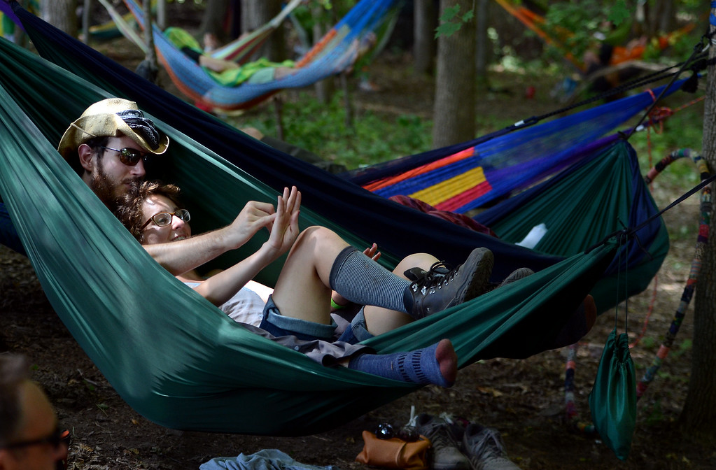 . Ian DeMenna and Bianca Bernier lay together in a hammock in the Ducimer Grove area at the 53rd Annual Philadelphia Folk Festival on Sunday August 17,2014. Photo by Mark C Psoras/The Reporter