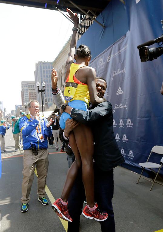 . Atsede Baysa, of Ethiopia, gets a lift as she celebrates after winning the women\'s division of the 120th Boston Marathon on Monday, April 18, 2016, in Boston. (AP Photo/Elise Amendola