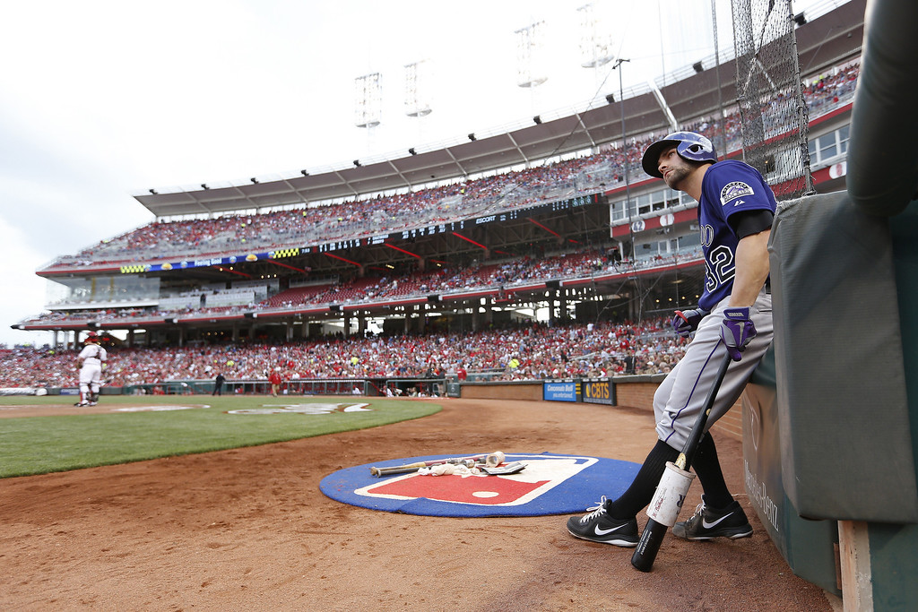 . Tyler Chatwood #32 of the Colorado Rockies waits during an umpire change in the game against the Cincinnati Reds at Great American Ball Park on June 3, 2013 in Cincinnati, Ohio. (Photo by Joe Robbins/Getty Images)