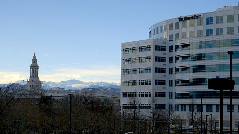 . The Denver Post, Mount Evans and Denver City Hall are seen in downtown Denver. (Courtesy of Zachary Armstrong)
