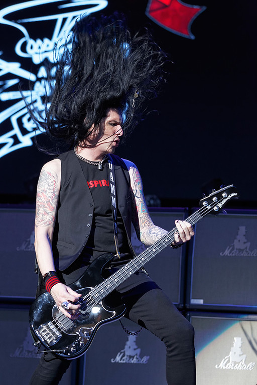 . Todd Kerns of Slash with Myles Kennedy & The Conspirators performs on Tuesday, Sept. 9, 2014, at DTE Energy Music Theatre in Independence Township. Photo by Ken Settle