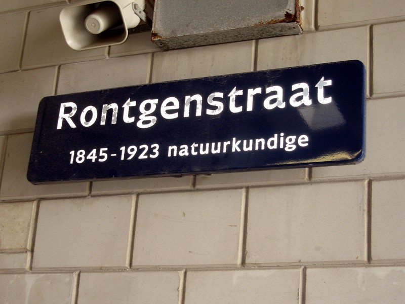 "Sign at the nuclear scanning tunnel operated by the Dutch Customs Administration at the Port of Rotterdam.  Wilhelm Conrad Röntgen was the first winner of the Nobel Prize in Physics, for his discovery of x-rays.  The röntgen, named after him, is a unit of measurement for exposure to radiation, and ""straat"" is Dutch for ""street."""