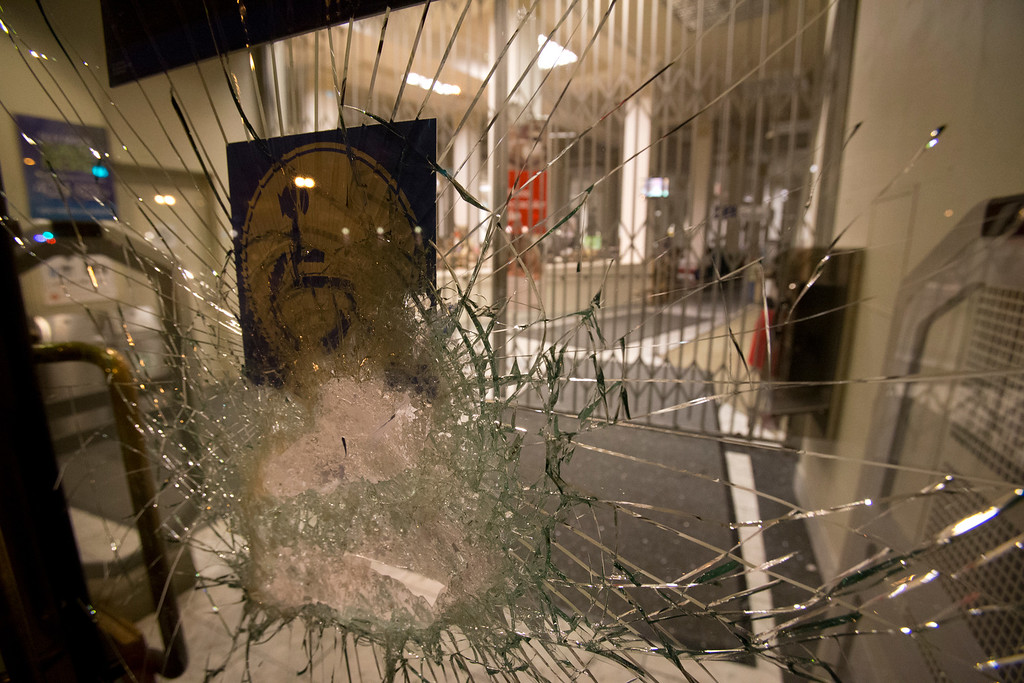 . Broken glass in the door of a Sears store on Telegraph Avenue, damaged by marchers during a protest of the verdict in the Trayvon Martin murder trial last Saturday in Sanford, Fla., Monday, July 15, 2013 in Oakland, Calif. (D. Ross Cameron/Bay Area News Group)