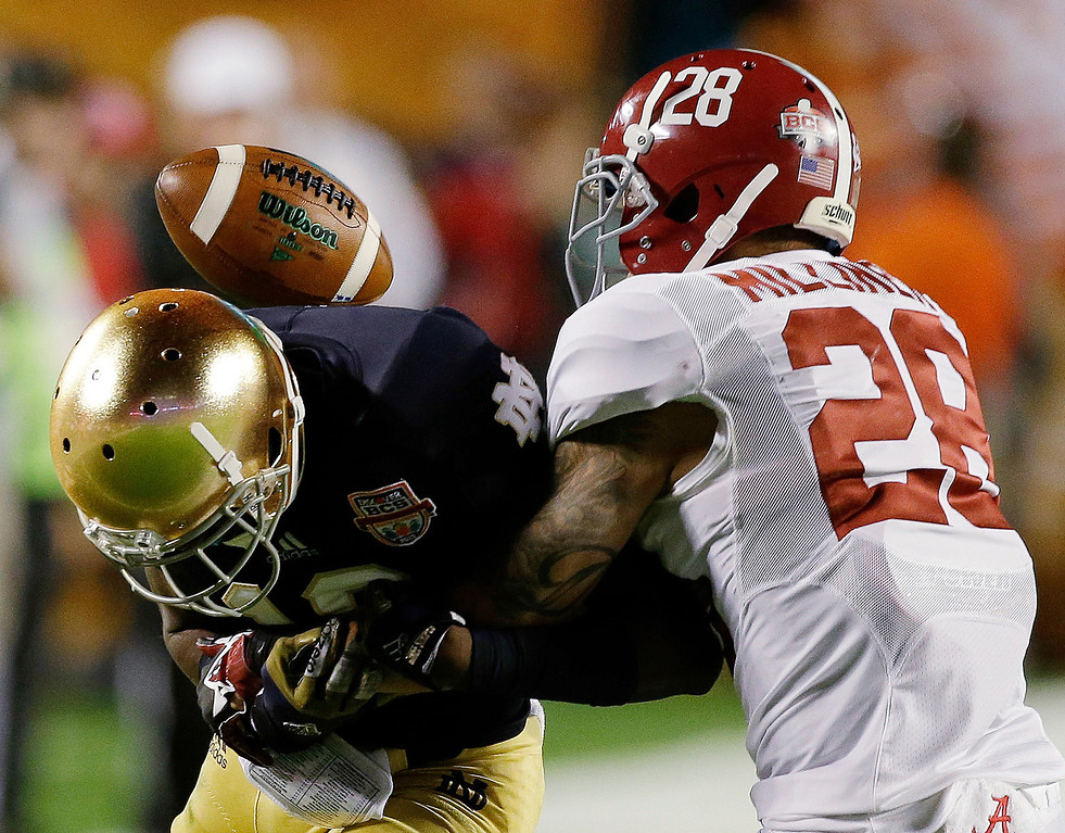 . Alabama\'s Dee Milliner (28) breaks up a pass intended for Notre Dame\'s DaVaris Daniels during the first half of the BCS National Championship college football game Monday, Jan. 7, 2013, in Miami. (AP Photo/Chris O\'Meara)