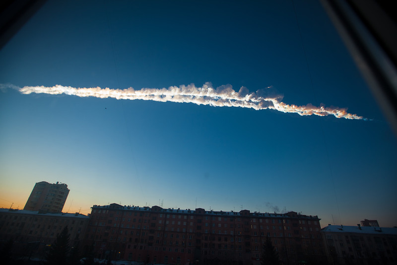 . In this photo provided by Chelyabinsk.ru a meteorite contrail is seen over Chelyabinsk on Friday, Feb. 15, 2013. A meteor streaked across the sky of Russiaís Ural Mountains on Friday morning, causing sharp explosions and reportedly injuring around 100 people, including many hurt by broken glass. (AP Photo/Chelyabinsk.ru)